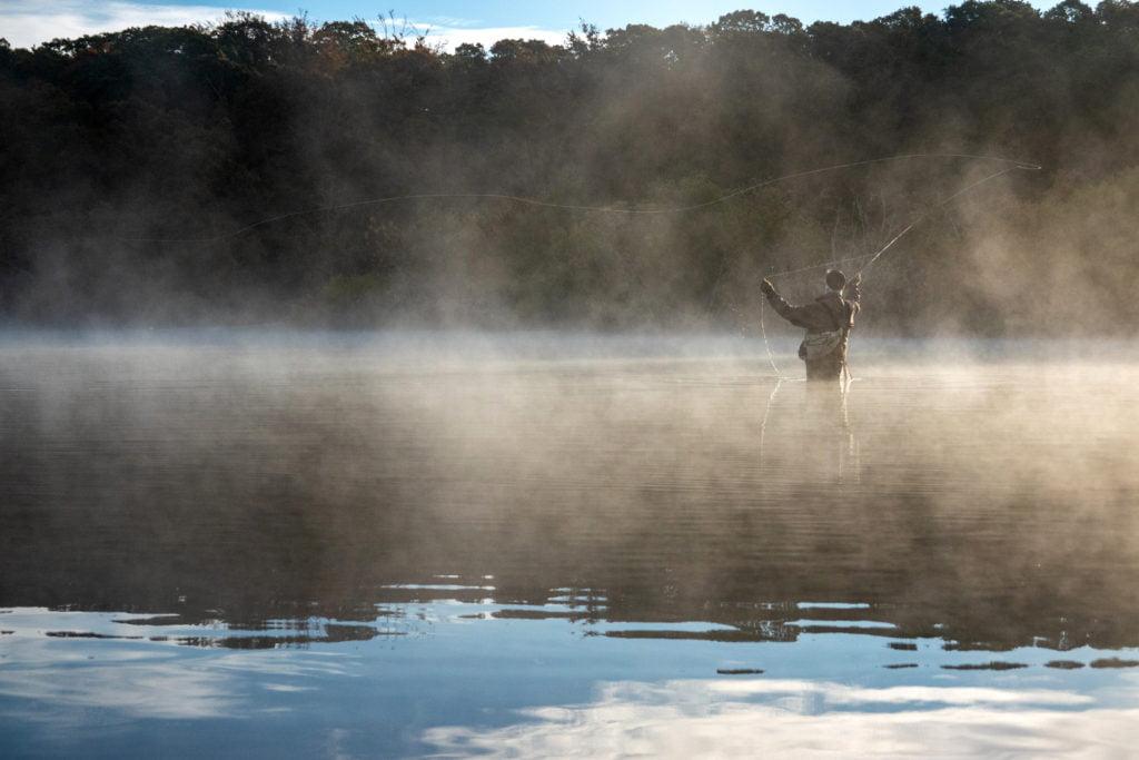 Fly fisherman in fog